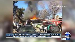 Two people taken to hospital after Lakewood home catches fire - Video
