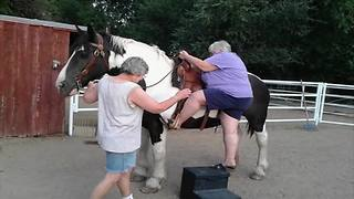 Woman Tries To Get Off A Horse - Video