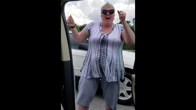 Woman Stuck In Traffic Jam Dances On Highway - Video