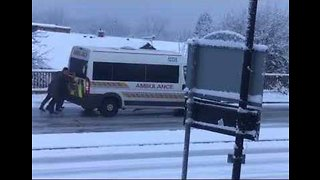 Office Workers Push Start Ambulance Stuck on Icy Road