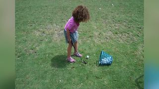 Adorable Little Girl Fails At Hitting A Golf Ball - Video