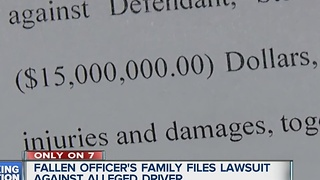 Officers family sues over his death