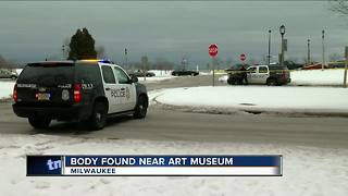 Police investigate body found near art museum - Video