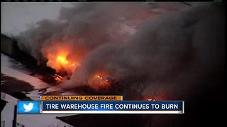 Tire warehouse on nirth side still burning into a second day - Video