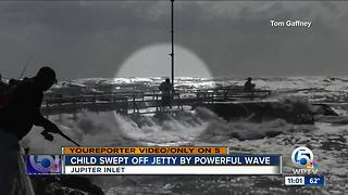Child swept off jetty by powerful wave - Video