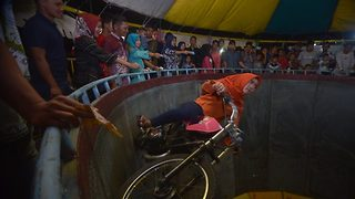 Indonesian hijabi girl performs dangerous stunts including a bike stand in well of death without safety gears