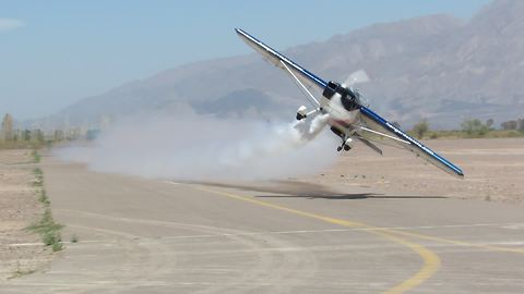 Stunt plane pulls off flawless low pass