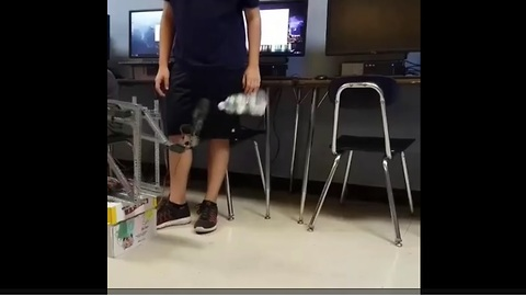 High school students build robot that perfectly flips water bottle