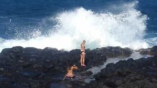 Rogue wave wipes out photo session
