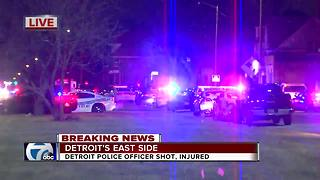 Police on scene of barricaded suspect after police officer wounded on Detroit's east side - Video