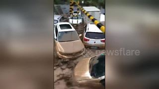 Cars swept away as flash floods surge through streets of Chinese city - Video