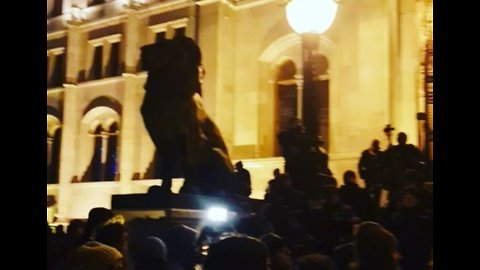 Hungary Protesters Chant 'Democracy' in Front of Parliament Building