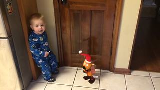 """""""A Tot Boy Dances With A Dancing Christmas Toy"""""""