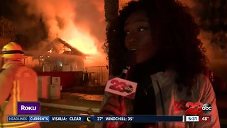 Firefighters battling house fire - Video