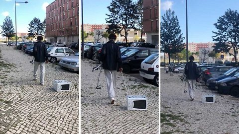 Micro-walkies – Man takes microwave for a walk on lead