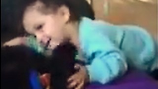 Cute Little Girl and Dog Playing