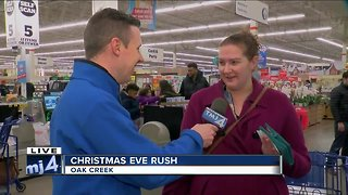 Last-minute shoppers cram stores looking for deals, meals