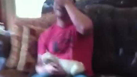 Man get surprised with French Bulldog puppy