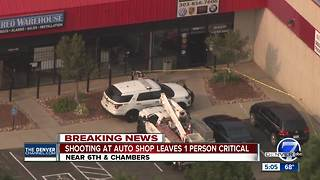 Man in critical condition after shooting at Aurora auto repair shop - Video