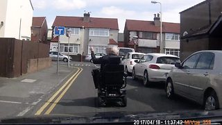 'Drunk' oap rides mobility scooter in middle of road – then unleashes abuse on hapless driver - Video