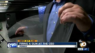 Window protects CEO from a gunman - Video