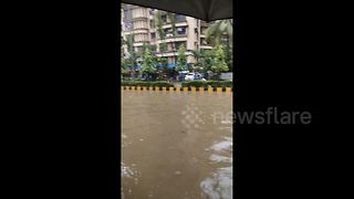 Monsoon rain floods streets in Mumbai causing travel disruption - Video