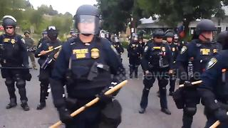 ICE protester in Portland films barricade of federal officers in riot gear - Video