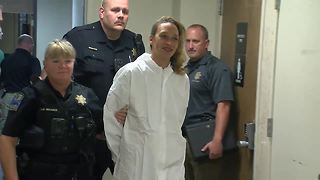 Woman accused of stabbing daughter seen smiling after arrest - Video
