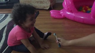"Baby finds ""walking"" toothbrush absolutely hysterical"