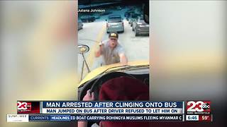 Man arrested after jumping on school bus - Video