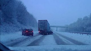 Hair-raising moment car ploughs into lorry on snowy M20 - Video