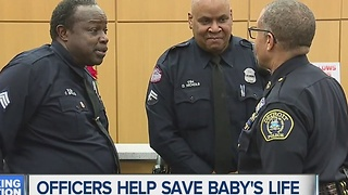 Officers help save baby's life - Video