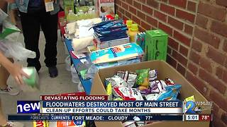 Dozens team up to help shop owners in Ellicott City after flood damage