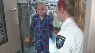 Ada County officials deliver toys to hospitalized kids - Video