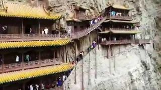 Drone films ancient 'hanging temple' in China - Video