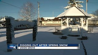 Digging out after spring snow in Union Grove
