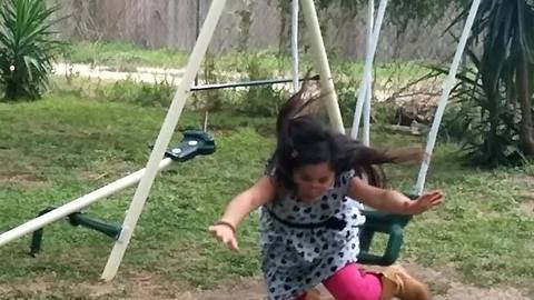Girl Fails In Jumping Off Swing