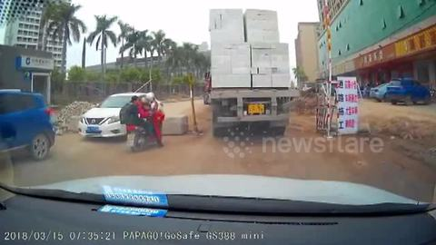 Driver lucky to survive after huge bricks fall from lorry, crushing vehicle