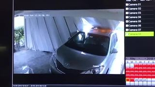 Surveillance video shows carport falling on vehicle - Video