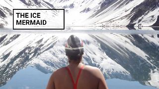 Would you swim in a freezing lake for fun? - Video