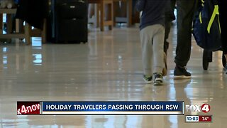 Holiday travelers passing through RSW
