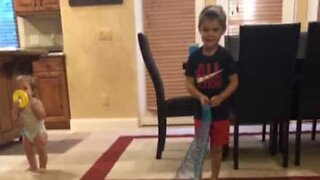 Dad hits son with slinky