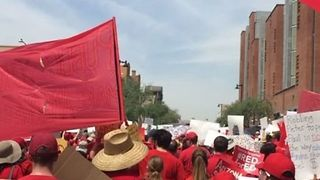 Arizona Teachers in Red March Through Downtown Phoenix - Video