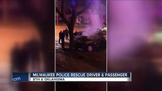 Milwaukee police rescue two from smoking car - Video