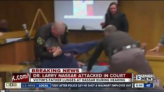 Father tries to attack Dr. Larry Nassar in court