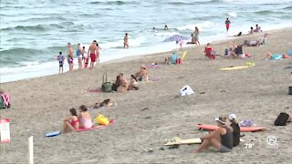 People enjoying the beach and Labor Day together