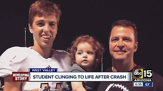 Student clinging to life after crash - Video