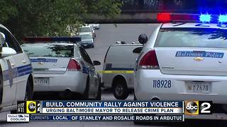 Organization rallies with community against crime, urges Pugh for crime plan - Video