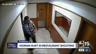 Police searching for men after woman shot at west Phoenix restaurant - Video
