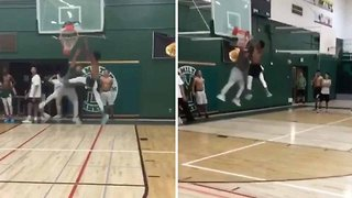 Basketball player smashes backboard after epic slam dunk
